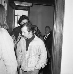 "The man who inspired ""Kid Charlemagne"" walks out of an arraignment in San Francisco after he was busted for 350,000 doses of LSD found in one of his labs. He would later be sentenced to 3 years."